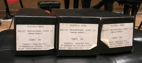 The boxes for the three pianola rolls
