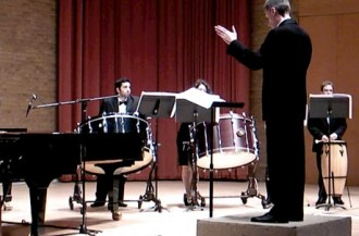 The drum section and Paul Jackson, Conductor